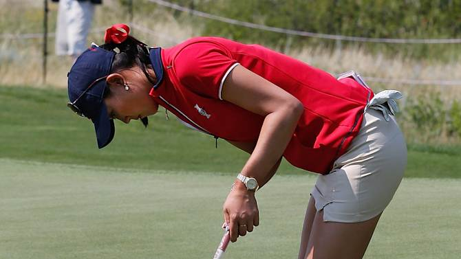 United States' Michelle Wie works on her putting during a practice round for the Solheim Cup golf tournament, Wednesday, Aug. 14, 2013, in Parker, Colo. The Solheim Cup, a biennial event between teams representing Europe and the United States, starts Friday. (AP Photo/Ed Andrieski)
