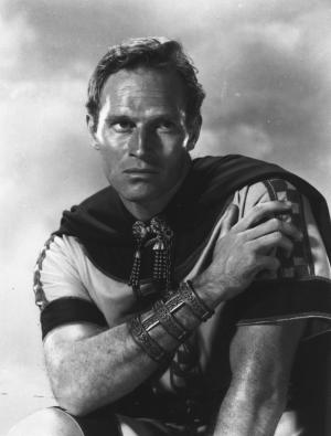 """FILE - This 1958 file image released by Metro-Goldwyn-Mayer shows actor Charlton Heston in the 1958 film """"Ben-Hur."""" Mark Burnett and Roma Downey will produce a new version of the historical epic """"Ben-Hur,"""" as the faith-based film revival continues on the big screen. Paramount Pictures and MGM announced Friday, April 25, 2014, that they will co-produce """"Ben-Hur"""" with Burnett and Downey, who also made the recent miniseries """"The Bible."""" The film is set for release February 2016. (AP Photo/Metro-Goldwyn-Mayer, File)"""