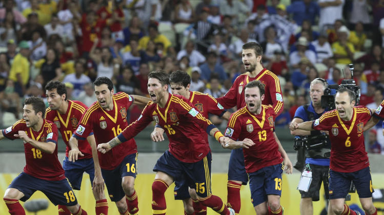 Spain's players celebrate after defeating Italy in a penalty shootout during the soccer Confederations Cup semifinal match at Castelao stadium in Fortaleza, Brazil, Thursday, June 27, 2013. (AP Photo/Eugene Hoshiko)