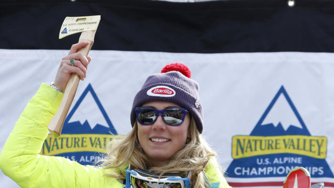 Mikaela Shiffrin, of Vail, Colo., holds her award after winning the women's slalom ski race at the U.S. Alpine Championships, Saturday, March 28, 2015, at Sugarloaf Mountain Resort in Carrabassett Valley, Maine. (AP Photo/Robert F. Bukaty)