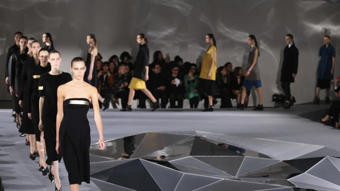 Models wear creations for Jil Sander women's Fall-Winter 2013-14 collection, part of the Milan Fashion Week, unveiled in Milan, Italy, Saturday, Feb. 23, 2013. (AP Photo/Antonio Calanni)