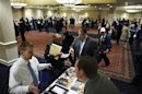 Job seekers speak with with job recruiters while they attend the Coast to Coast job fair in New York