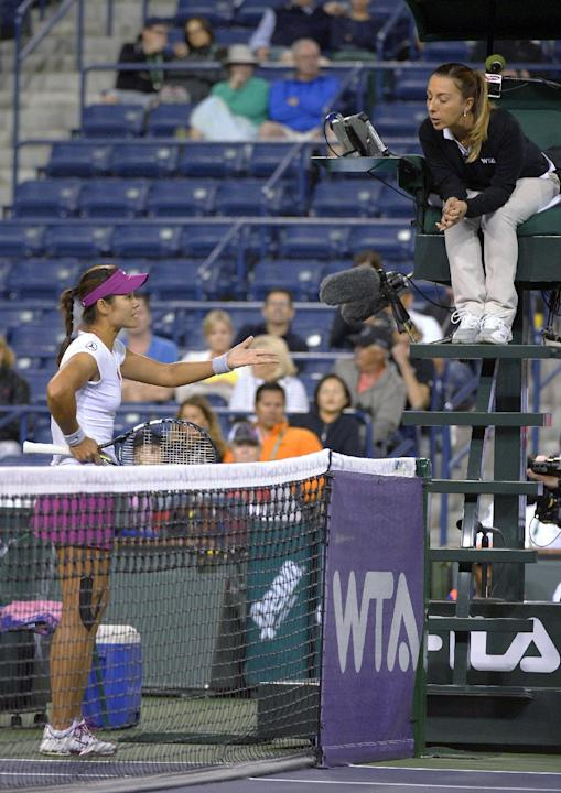 Li Na, of China, argues with the chair umpire after winning a challenge on a call, but still having to replay the point against Aleksandra Wozniak, of Canada, at the BNP Paribas Open tennis tournament