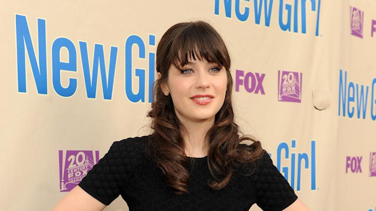 "Actor Zooey Deschanel arrives at FOX's ""New Girl"" screening and Q&A at the Academy of Television Arts & Sciences' Leonard H. Goldenson Theater on Tuesday, April 30, 2013 in North Hollywood, California. (Photo by Frank Micelotta/Invision for FOX/AP Images)"