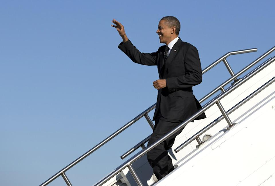 President Barack Obama arrives at Rickenbacker Inland Port on Air Force One, Tuesday, Oct. 9, 2012, in Columbus, Ohio. (AP Photo/Carolyn Kaster)