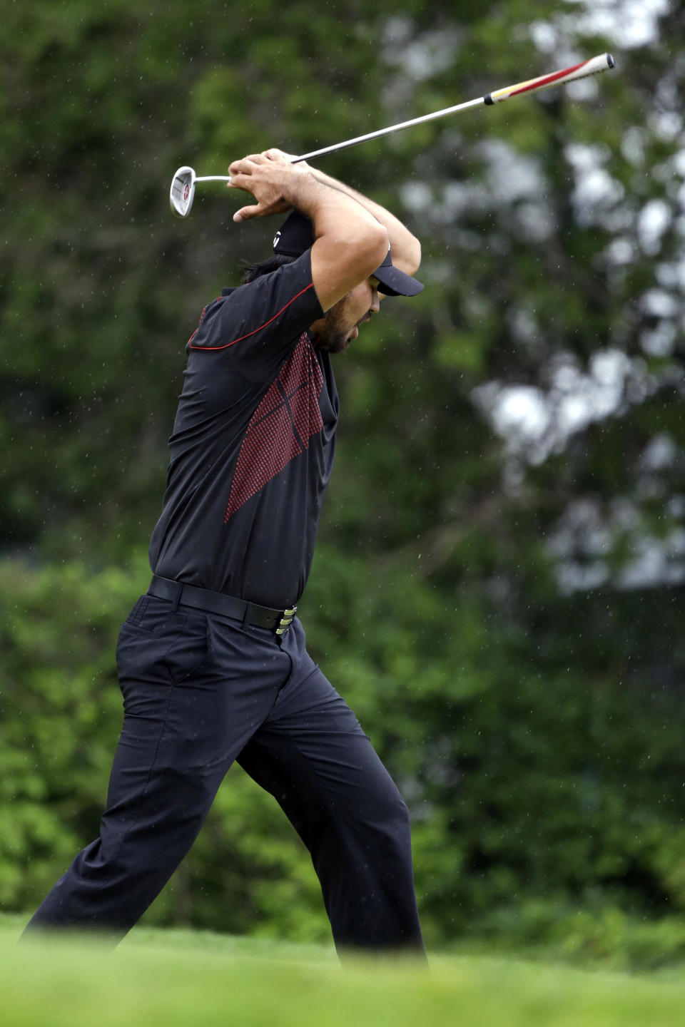Jason Day, of Australia, reacts after a putt on the 15th hole during the fourth round of the U.S. Open golf tournament at Merion Golf Club, Sunday, June 16, 2013, in Ardmore, Pa. (AP Photo/Darron Cummings)