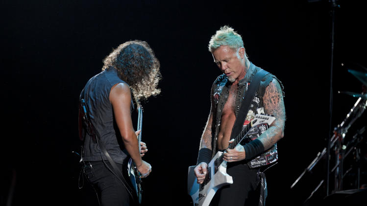 "Lead singer James Hetfield, right, and Kirk Hammett, guitar, of the heavy metal rock band ""Metallica"" perform during a concert at the Sports Palace, in Mexico City, Saturday, July 28, 2012. (AP Photo/Christian Palma)"