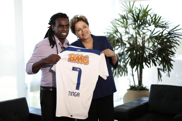 Brazil's President Dilma Rousseff poses with Brazilian soccer player Tinga, who plays for Cruzeiro club, in Brasilia