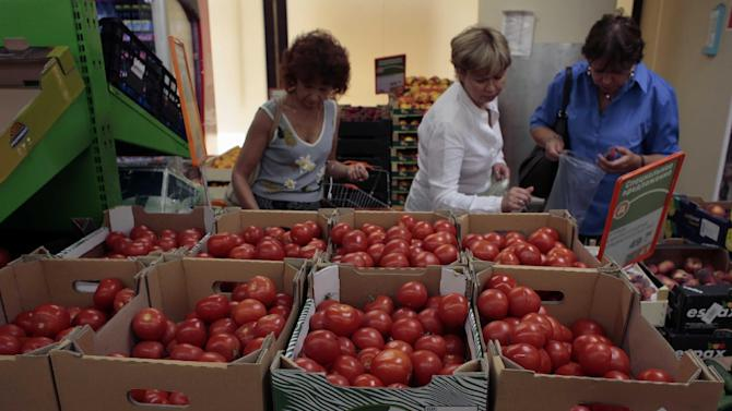 Women choose Dutch tomatoes at a supermarket in downtown Moscow on Thursday.