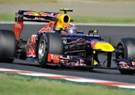 "Red Bull-Renault driver Mark Webber of Australia takes the hairpin turn during the second practice session of the Formula One Japanese Grand Prix at the Suzuka circuit on October 5. Webber swept to the quickest practice time but shrugged off Lewis Hamilton's predictions the team would dominate as mere ""mind games"""