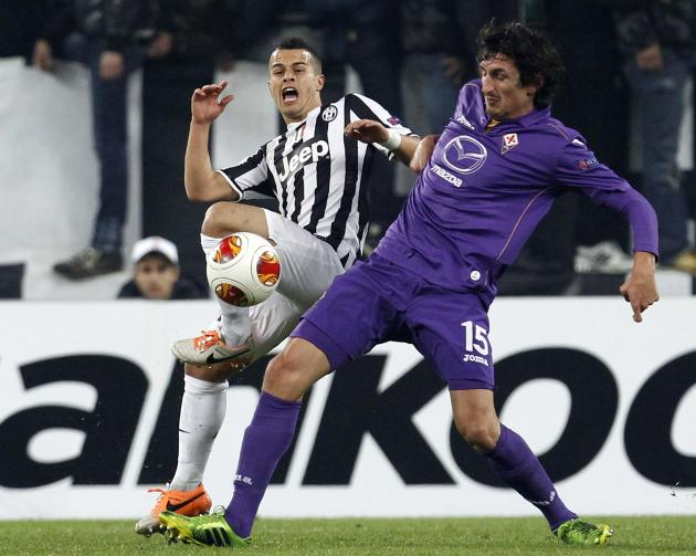 Juventus' Sebastian Giovinco fights for the ball with Fiorentina's Stefan Savic during their Europa League round of 16 first leg soccer match in Turin
