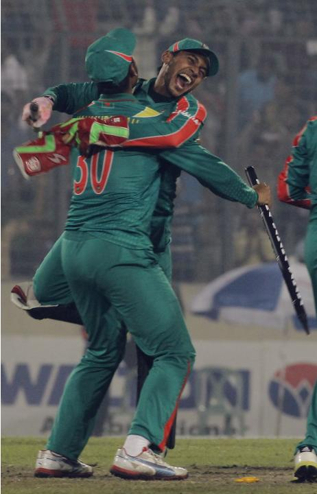 Bangladesh's captain Rahim and vice captain Mahmudullah celebrate after winning the second one-day international cricket match and the series against New Zealand in Dhaka