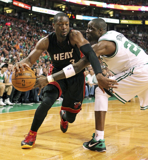 Miami Heat's Dwyane Wade, left, struggles to get around Boston Celtics' Mickael Pietrus in the second quarter of Game 4 in their NBA basketball Eastern Conference finals playoffs series in Boston, Sun