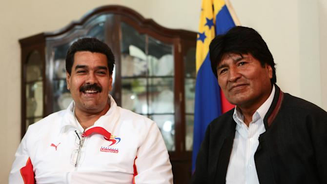 In this photo provided by Miraflores Presidential Press Office, Venezuela's Vice President Nicolas Maduro, left, smiles during a meeting with Bolivia's President Evo Morales in Caracas, Venezuela, Tuesday, Feb. 19, 2013. Morales is in Caracas Tuesday to visit Venezuela's President Hugo Chavez, who is back home after 10 weeks of cancer treatment in Cuba. (AP Photo/Miraflores Presidential Office)