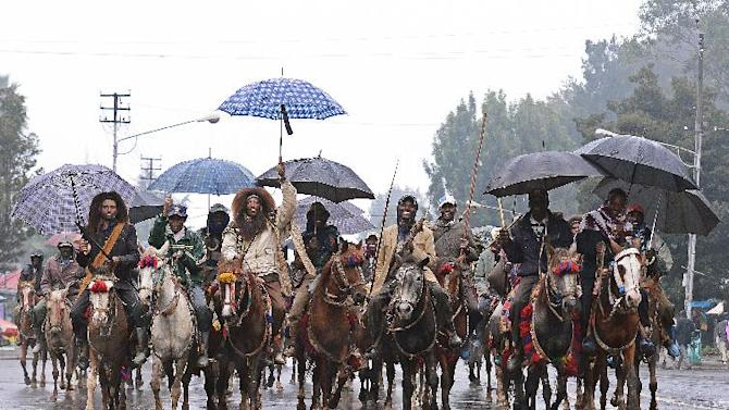 Ethiopians wearing traditional Oromo costume ride in Addis Ababa on August 31, 2012