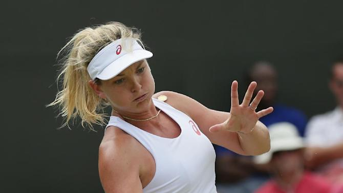 Coco Vandeweghe of the United States makes a return to Lucie Safarova of the Czech Republic during their singles match at the All England Lawn Tennis Championships in Wimbledon, London, Monday July 6, 2015. (AP Photo/Tim Ireland)