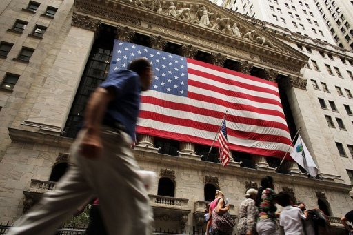 &lt;p&gt;A man walks by the New York Stock Exchange on September 6. US stock markets turned a weak jobs report into positive news Friday, ending higher on expectations that the data will lead to new Federal Reserve efforts to help the economy.&lt;/p&gt;