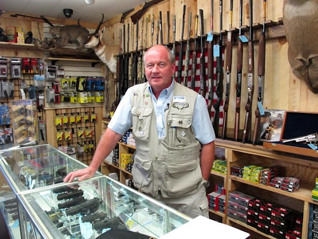 This photo taken Aug. 22, 2012, shows Central Wisconsin Firearms owner Frederick Prehn in his store in Wausau, Wis. He says he's had to expand his business to the new location last summer because of increased gun sales. He attributes the spike to Wisconsin's new concealed carry law as well as the uncertainty about the upcoming election. President Barack Obama is presiding over a heyday for the gun industry despite predictions he would be the most anti-gun president in history. An Associated Press analysis finds gun sales are on the rise and stocks of major gun companies are up. The number of federally licensed gun dealers is increasing for the first time in nearly 20 years. And the National Rifle Association is bursting with cash and political clout. (AP Photo/Carrie Antlfinger)