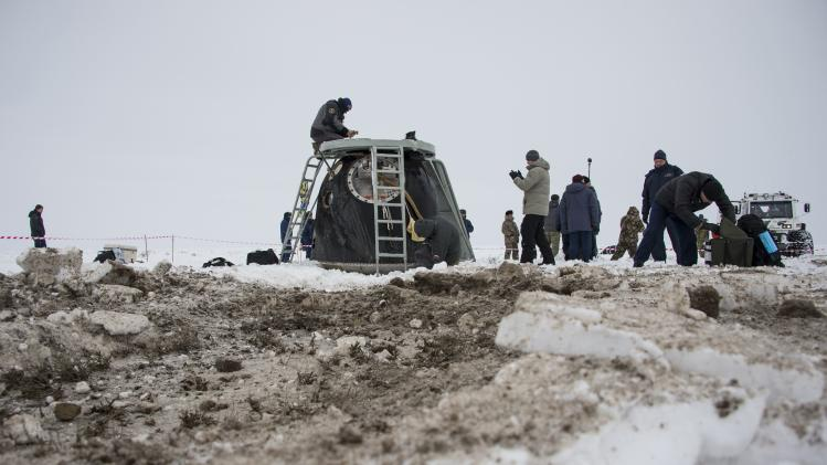 The Soyuz TMA-10M capsule is seen shortly after it landed with former ISS commander Kotov and flight engineers Ryazansky and Hopkins from NASA onboard in a remote area southeast of Zhezkazgan