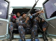 File photo of police in Papua New Guinea. Pollice have arrested members of an alleged cannibal cult accused of killing at least seven people, eating their brains raw and making soup from their penises, a report said Friday
