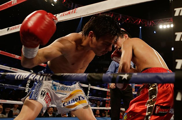 HOUSTON, TX - DECEMBER 15:  Nonito Donaire of the Philippines (R) knocks out Jorge Arce of Mexico in the third round of their WBO World Super Bantamweight bout at the Toyota Center on December 15, 2012 in Houston, Texas.  (Photo by Scott Halleran/Getty Images)