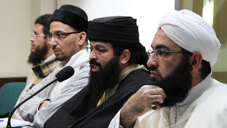 FILE - In this Feb. 9, 2012 file photo Muslim cleric Omar Heddouchi speaks at a press conference with fellow former detainees Hassan al-Kettani, right, and Abou Hafs, left, in Rabat, Morocco. The three clerics of the ultraconservative Salafi strand of Islam in Morocco, backed a death threat by a preacher against a journalist supporting greater sexual freedom in the North African kingdom. (AP Photo/Paul Schemm, File)