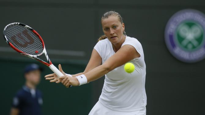 Petra Kvitova of Czech Republic plays a return to Ekaterina Makarova of Russia during their Women's singles match at the All England Lawn Tennis Championships in Wimbledon, London, Friday, June 28, 2013. (AP Photo/Kirsty Wigglesworth)