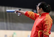 Gold medalist Chinese Guo Wenjun competes in the women's 10m air pistol event at the Royal artillery Barracks in London, during the London 2012 Olympic Games