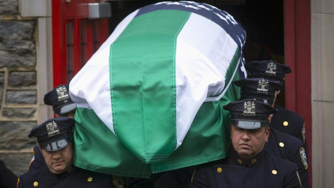 NYPD officers carry the casket containing NYPD Detective Paul Duncan from the Abyssinian Baptist Church following his funeral service in the Harlem section of Manhattan