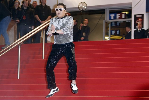 The real Psy arrives at the Palais des Festivals in Cannes for the NRJ Music Awards on January 26, 2013