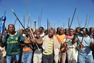 Thousands of South African mine workers walk on September 10 to the Lonmin mine in Marikana to try and stop other miners from going to work. The body of a man hacked to death was found at the Marikana platinum mine in South Africa where a protracted wildcat strike has already left 44 dead, police said Tuesday