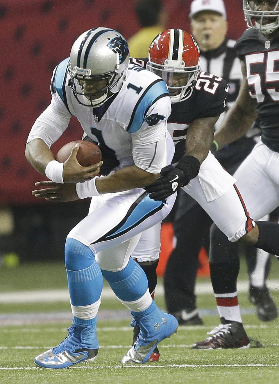 Carolina Panthers quarterback Cam Newton (1) is stopped by Atlanta Falcons strong safety William Moore (25) during the first half of an NFL football game Sunday, Sept. 30, 2012, in Atlanta. (AP Photo/David Goldman)