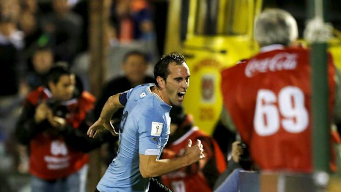 Uruguay's Diego Godin celebrates after scoring against Colombia during their 2018 World Cup qualifying soccer match at the Centenario stadium in Montevideo