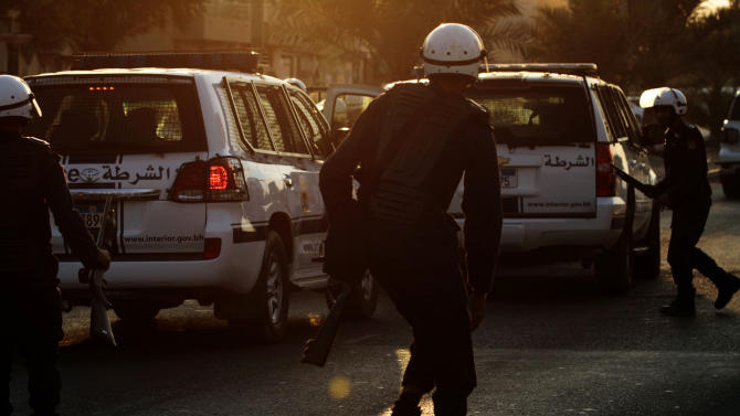 Riot policemen watch for Bahraini anti-government protesters trying to organize a march in Daih, Bahrain, on Saturday, Nov. 3, 2012, despite a ban on protests. A heavy police presence prevented protesters from gathering, and police dispersed and chased small groups through narrow streets as they emerged. (AP Photo/Hasan Jamali)