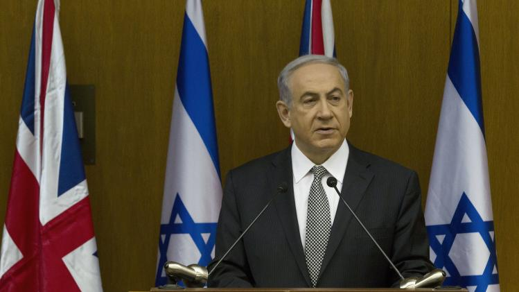 Israel's Prime Minister Netanyahu speaks during a news conference with Britain's Foreign Secretary Hammond in Jerusalem
