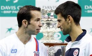 Serbian tennis team player Novak Djokovic and Czech tennis team player Radek Stepanek look at each other after the official draw for the Davis Cup final in Belgrade
