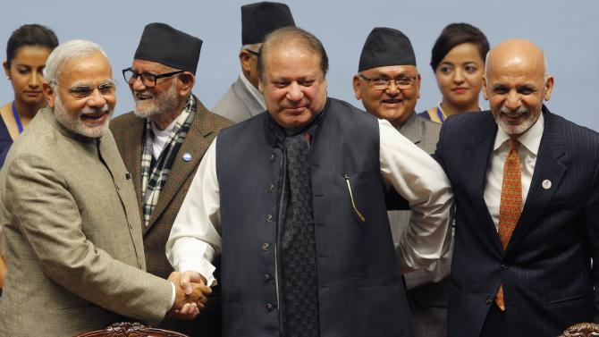 India's PM Modi shakes hands with his Pakistani counterpart Sharif as Nepal's PM Koirala and Afghanistan's President Ghani watch during the closing session of 18th SAARC summit in Kathmandu