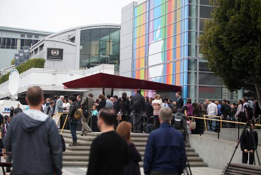 Journalists and guests line up outside of Yerba Buena Center for the Arts in San Francisco to attend Apple's special media event to introduce the iPhone 5, on September 12, 2012