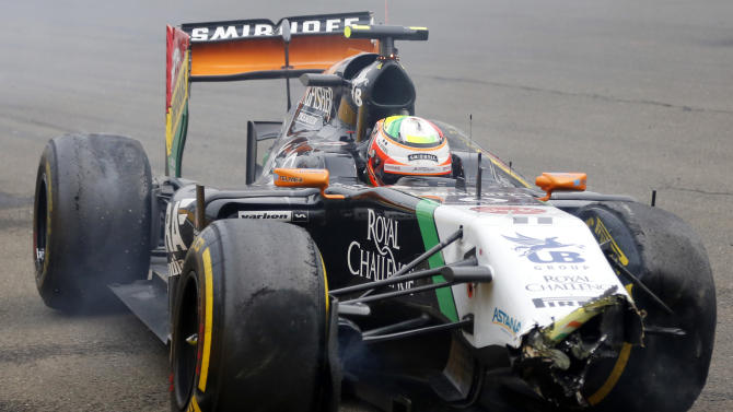 Force India's Mexican driver Sergio Perez sits in his wrecked car during the Hungarian Formula One Grand Prix at the Hungaroring circuit in Budapest on July 27, 2014