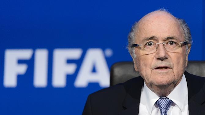 FIFA boss Sepp Blatter has said he will stand down as president on February 26 when an election for a new leader will be held