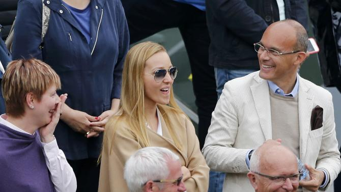 Jelena Djokovic, wife of player Novak Djokovic of Serbia follows his match against Jarkko Nieminen of Finland at the French Open tennis tournament at the Roland Garros stadium in Paris