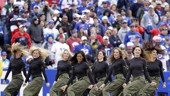 In this Nov. 17, 2013, photo, Buffalo Bills cheerleaders perform during the Bills' NFL football game against the New York Jets in Orchard Park, N.Y. The Bills will be playing without the support of their official cheerleaders this year. Stephanie Mateczun, whose company manages the Buffalo Jills cheerleading squad, said Thursday, April 24, 2014, she has suspended operations through at least the end of the season. The decision was made two days after five former Jills filed a lawsuit complaining they worked hundreds of hours for free, and were subjected to groping and sexual comments. (AP Photo/Heather Ainsworth)