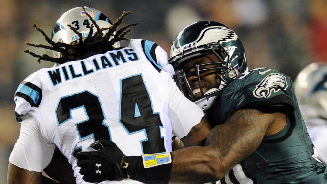 Philadelphia Eagles defensive back Colt Anderson, right, tries to tackle Carolina Panthers running back DeAngelo Williams in the second half of an NFL football game, Monday, Nov. 26, 2012, in Philadelphia. (AP Photo/Michael Perez)