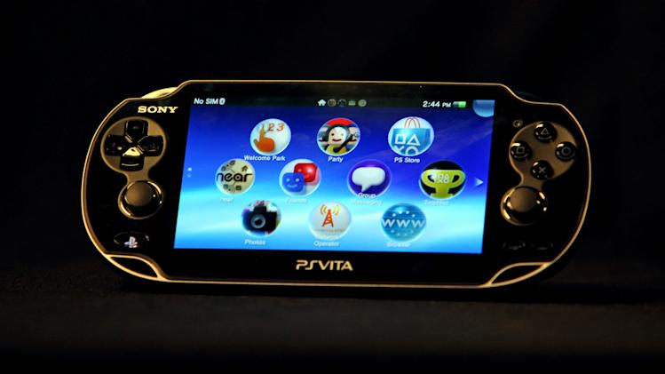"""FILE - This Feb. 15, 2012 file photo shows a Playstation PSVita. In the age of """"Angry Birds"""" and """"Words With Friends"""" dominating people's on-the-go playtime, Sony is making a push into the world of handheld gaming with a gadget aimed at loyal gamers and fans of the PlayStation. Sony says it has sold 1.2 million PlayStation Vitas worldwide. (AP Photo/Reed Saxon, File)"""
