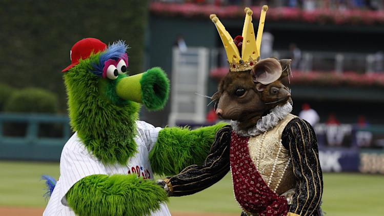 The Mouse King, right, from the Nutcracker, shakes hands with the Phillie Phanatic, left, after throwing out the first pitch prior to the first inning of a baseball game between the San Francisco Giants and the Philadelphia Phillies, Wednesday, July 23, 2014, in Philadelphia. (AP Photo/Chris Szagola)
