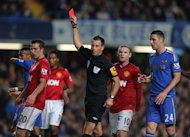 Referee Mark Clattenburg sent off two Chelsea players in a stormy clash at Stamford Bridge