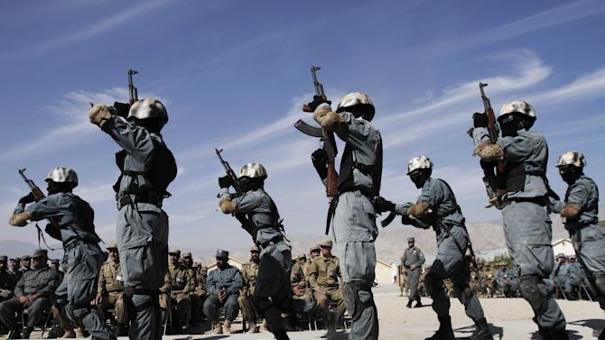 Newly graduated Afghan Local police officers demonstrate their skills during a graduation ceremony at a National Police training center in Laghman province, east of Kabul, Afghanistan, Wednesday, Nov. 7, 2012. Over 138 Local police officers graduated after receiving one months of training in Laghman. (AP Photo/Rahmat Gul)