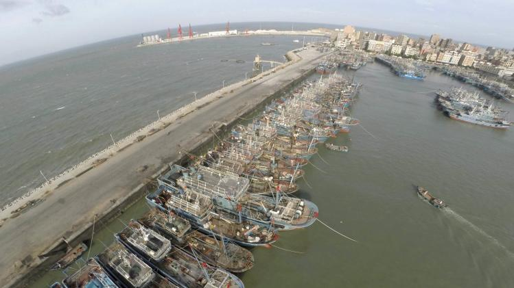 Fishing boats are seen docked at a port as Typhoon Matmo approaches, in Jinjiang