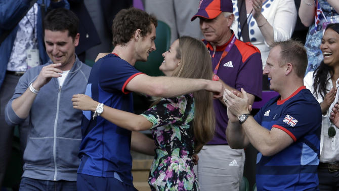 FILE - In this file photo dated Sunday, Aug. 5, 2012, Britain's Andy Murray, centre left, hugs his girlfriend Kim Sears, after defeating Switzerland's Roger Federer to win the men's singles 2012 Summer Olympics gold medal match, played at the All England Lawn Tennis Club, Wimbledon, in London. Murray has got engaged to his long-term girlfriend Kim Sears, his agent has confirmed Wednesday Nov. 26, 2014. (AP Photo/Victor R. Caivano, FILE)