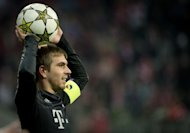 Bayern Munich's defender Philipp Lahm throws a ball during the UEFA Champions league group F football match between Bayern Munich and Lille OSC at the Allianz arena in Munich on November 7, 2012, which Bayern won 6-1. Lahm said on Thursday that he was delighted that last year's beaten finalists have drawn Arsenal in the last 16 of the Champions League